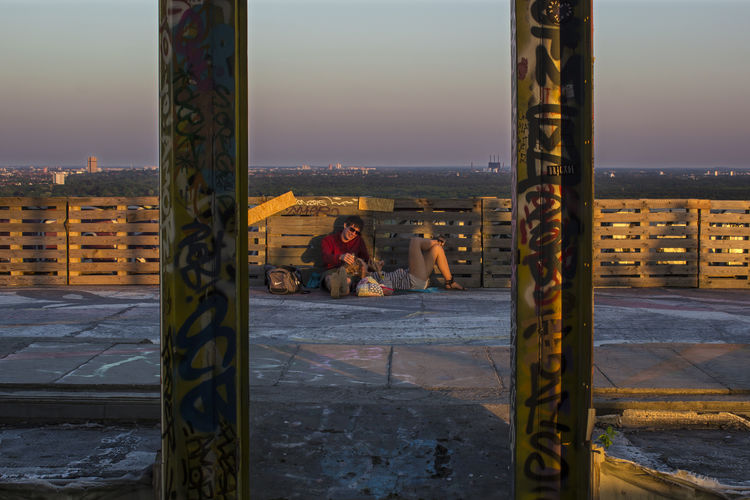 Love at Teufeslberg, the Devil's Mountain. FILIPPI GIULIA PHOTOGRAPHY. Abandoned Architecture Berlin Colors Day Forest Germany Graffiti Landscape Love Nature Outdoors People Photographer Photography Sky Spray Paint Street Street Art Streetphotography Sun Sunset Teufelsberg Two People Wild