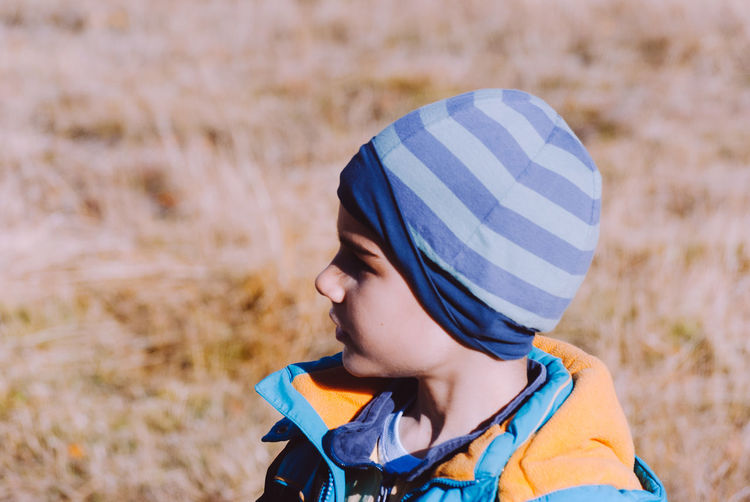 Boys Cap Childhood Close-up Day Elementary Age Field Focus On Foreground Headshot Headwear Helmet Leisure Activity Lifestyles Nature One Person Outdoors People Real People Warm Clothing