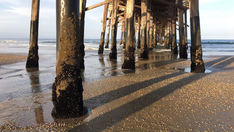 EyeEm Selects Sea Water Beach Horizon Over Water Nature Shadow Sky Sunlight Sand Scenics Day Architectural Column Outdoors No People Beauty In Nature Pier Pacific Ocean Newport Beach Pier