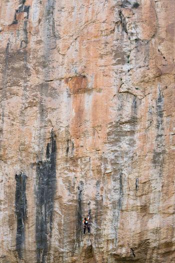 Full length of man climbing on rock formation
