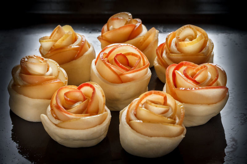 Buns-rosettes on a baking sheet, oiled. Bakery products. Cooking Oiled Raw Appetizing  Apple Slices Bakery Products Baking Sheet Baking Tray Blacckandwhite Close-up Concocting Day Dumpling  Food Freshness Healthy Eating Indoors  No People Rolls Rosettes Shorts Sweet Food