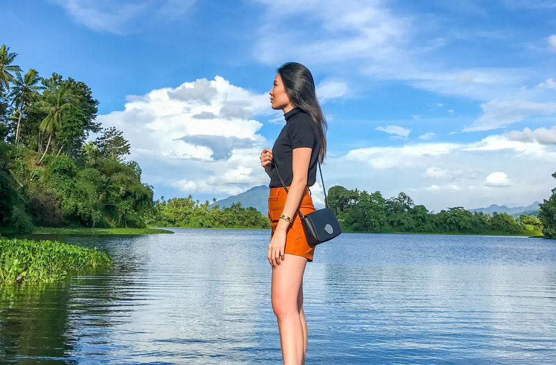 Young Girl in Beautiful Landscape Girl Young Girl Alone Scenics Tranquility Outdoors Water Young Women Tree Lake Women Summer Happiness Standing Beauty Three Quarter Length Countryside Idyllic Tranquil Scene Lakeside Horizon Over Water Foggy