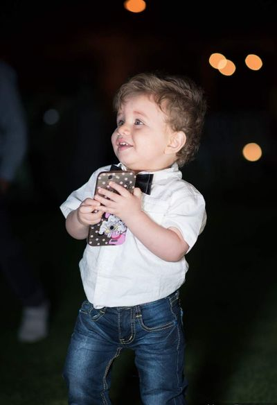 Happy child Children Only Child One Person Childhood People Casual Clothing Theatrical Performance Cute Night Portrait Girls Happiness Standing Playing One Boy Only Indoors  Popular Music Concert Adult EyeEmNewHere