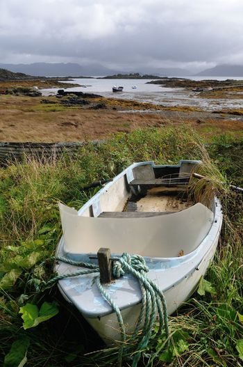 Boat ashore at Ardvaser, Isle of Skye Boat Coastline Grass Highlands Landscape Mode Of Transport Mountain No People Non-urban Scene Scotland Sky Skye Tranquility Water
