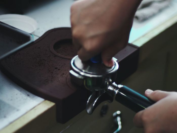 Cropped Hands Of Barista Preparing Coffee In Cafe