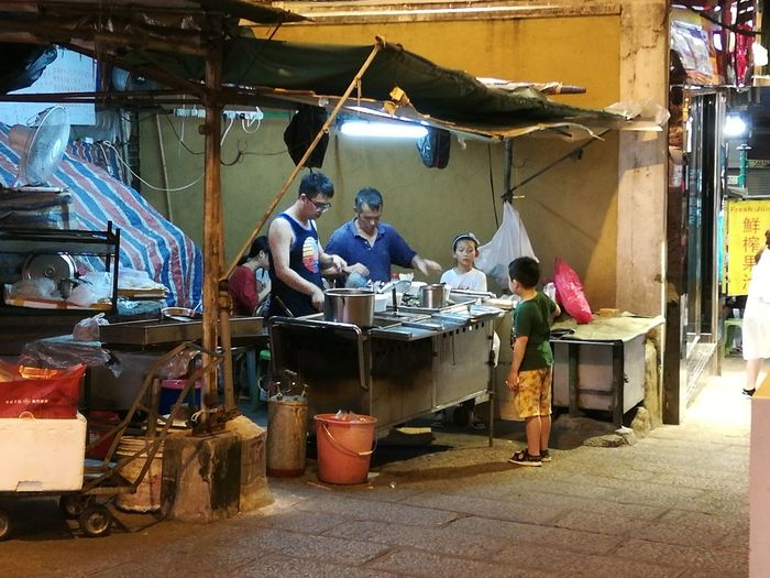 Food Vendor Working Hard Workers At Work Workplace Stall Stalls At Sunday Market Stallfood Working Full Length City Workshop Occupation Market Market Stall Stall Street Market Market Vendor Street Food Vendor Bazaar Display