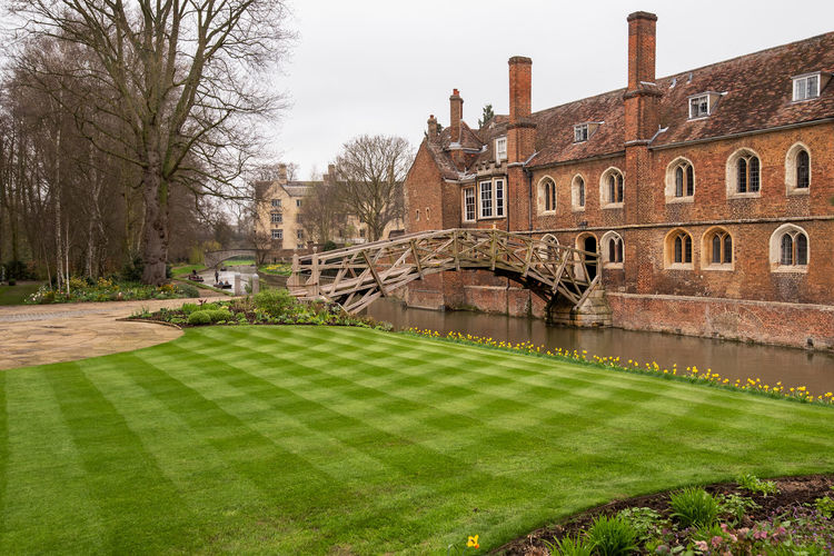 Cambridge Cambridgeshire River Cam University City Boating Green Grass Lined Grass Mathematical Bridge Patterns Punting Punts River River Crossing Architecture Built Structure Building Exterior Building Plant Tree Nature Grass Water No People Lawn Travel Destinations Green Color Day History The Past Sky Residential District Outdoors Bridge Canal Luxury