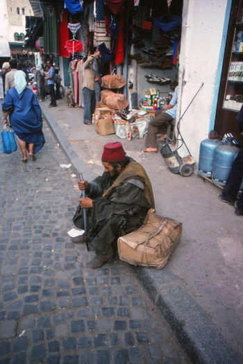 City Life Lifestyles Man Morocco Perspective Sitting Steeet Life Traditional Costume