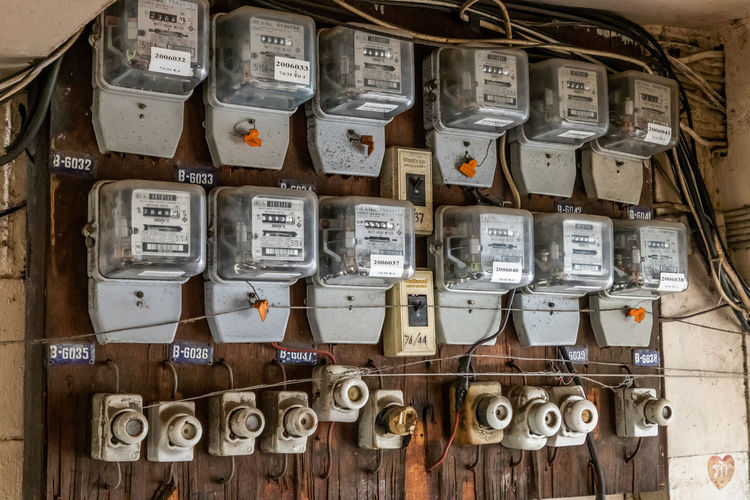 Close-up of electrical meters on wall