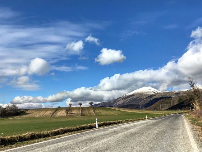 Road Landscape Sky The Way Forward Cloud - Sky Day Nature Transportation Scenics Tranquil Scene Outdoors Beauty In Nature Tranquility Mountain No People Blue Rural Scene Winding Road Grass