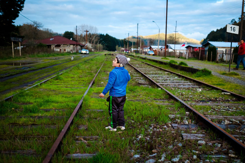 Architecture Boys Casual Clothing Childhood Fujifilm_xseries Fujifilmxpro1 Full Length Grass Green Color Outdoors Railroad Railroad Track Sky Streetphotographer Streetphotography The Way Forward Trains Valdivia, Chile Xpro1