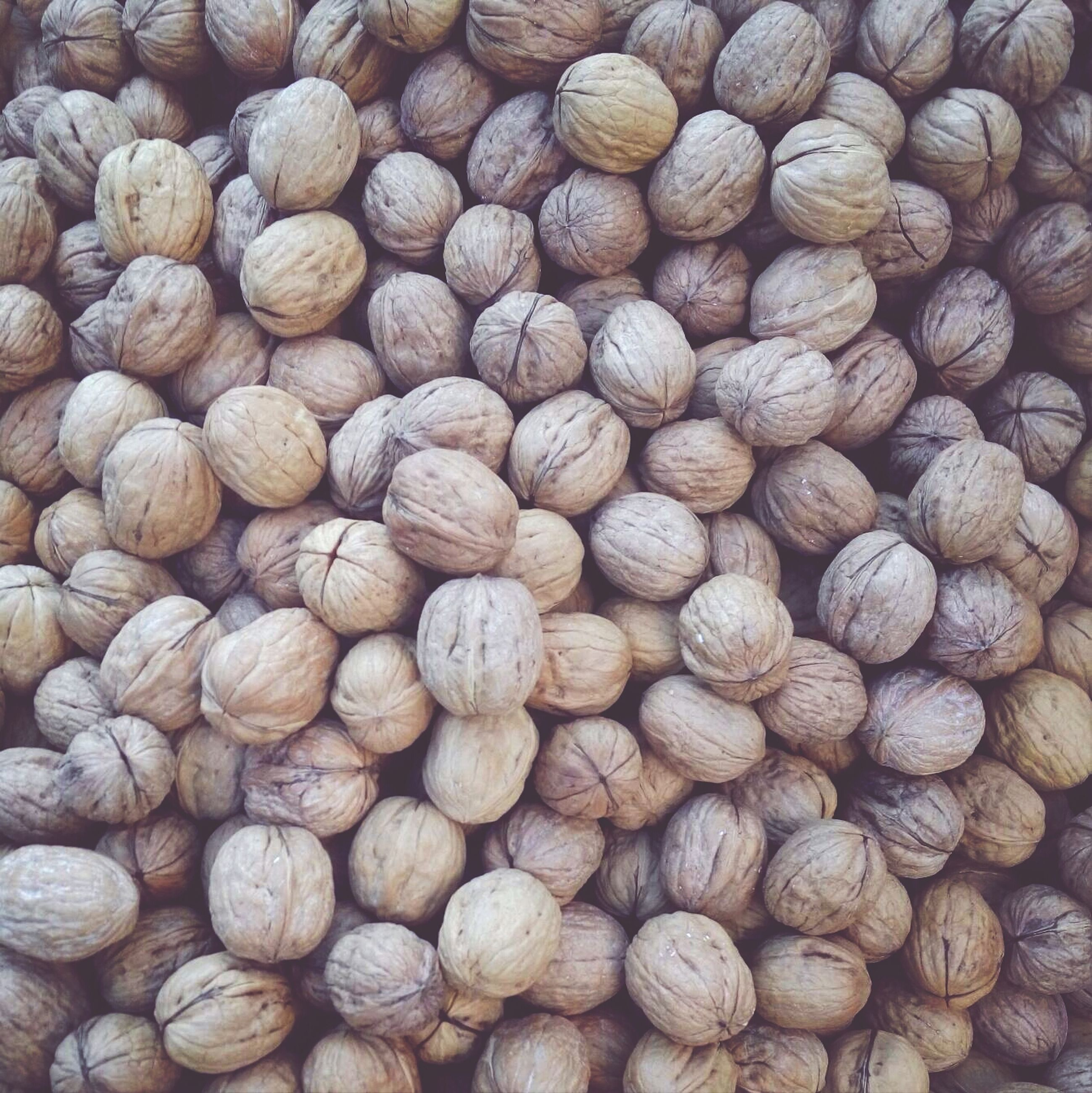 full frame, backgrounds, food and drink, abundance, large group of objects, food, freshness, brown, still life, healthy eating, close-up, high angle view, nut - food, indoors, stack, no people, directly above, heap, textured, pattern