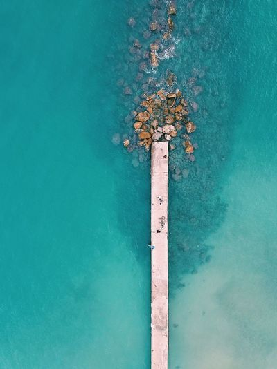 High angle view of swimming pool by sea