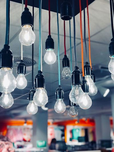 Light EyeEm Selects Hanging Lighting Equipment Decoration Illuminated Indoors  No People Close-up Pendant Light Focus On Foreground Light In A Row Large Group Of Objects Built Structure Electric Lamp