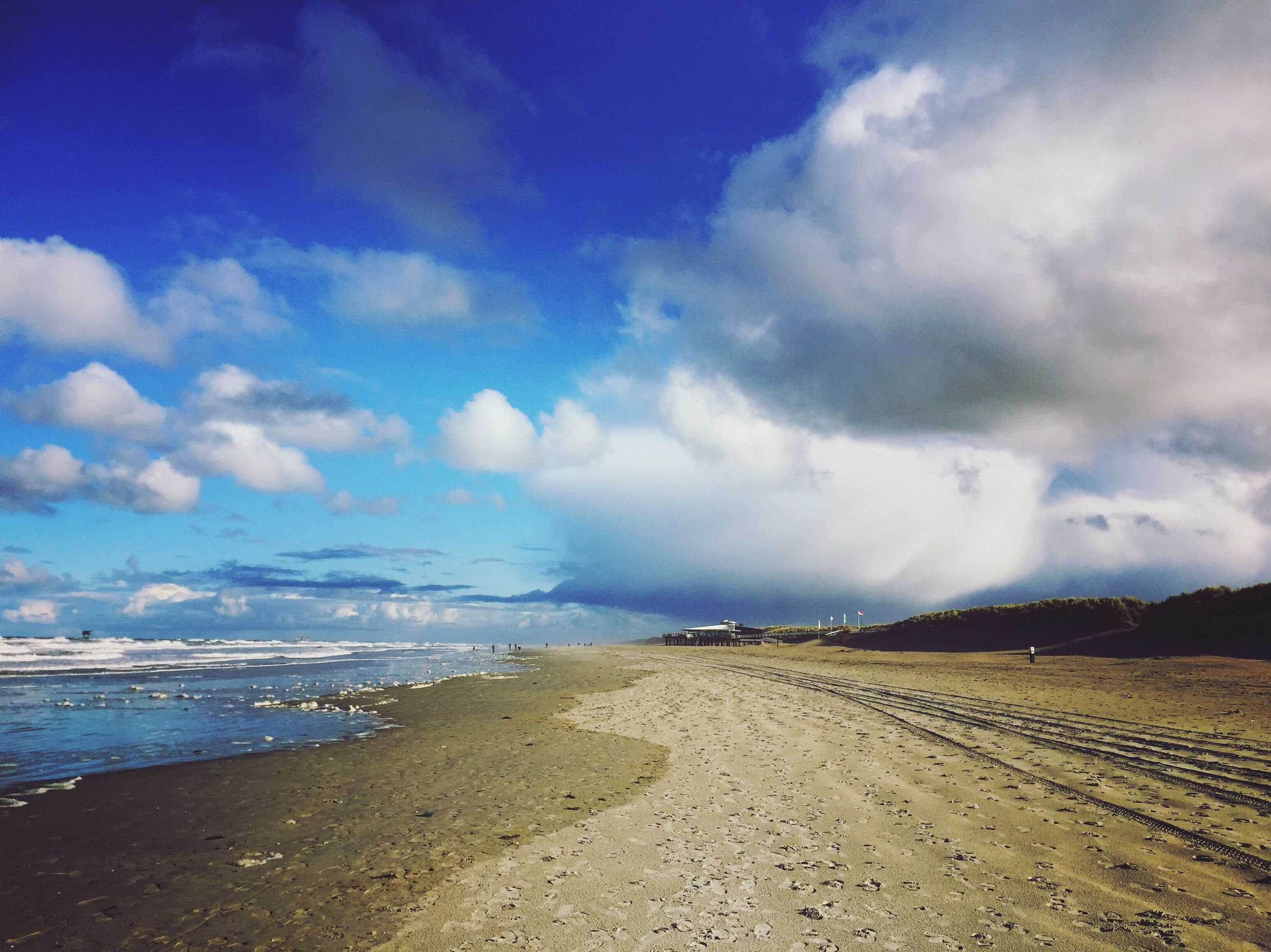 sea, beach, sky, cloud - sky, sand, water, horizon over water, nature, blue, scenics, beauty in nature, tranquil scene, tranquility, no people, outdoors, day, wave