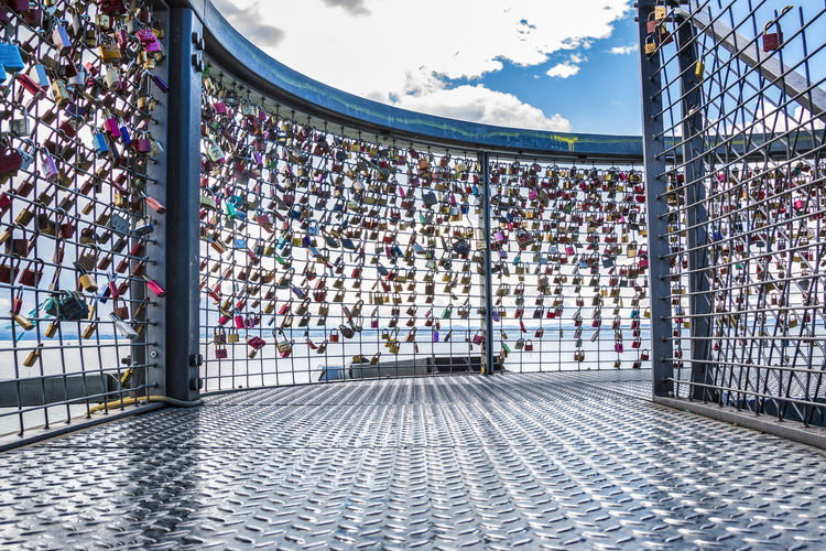 padlocks of love Love Padlocks Architecture Barrier Boundary Cloud - Sky Crowd Day Fence Group Of People Large Group Of People Nature Outdoors Padlocks Of Love Padlocks, Lovers Locks, Promises, True Love, Romance Protection Railing Real People Safety Security Sky Spectator Stadium