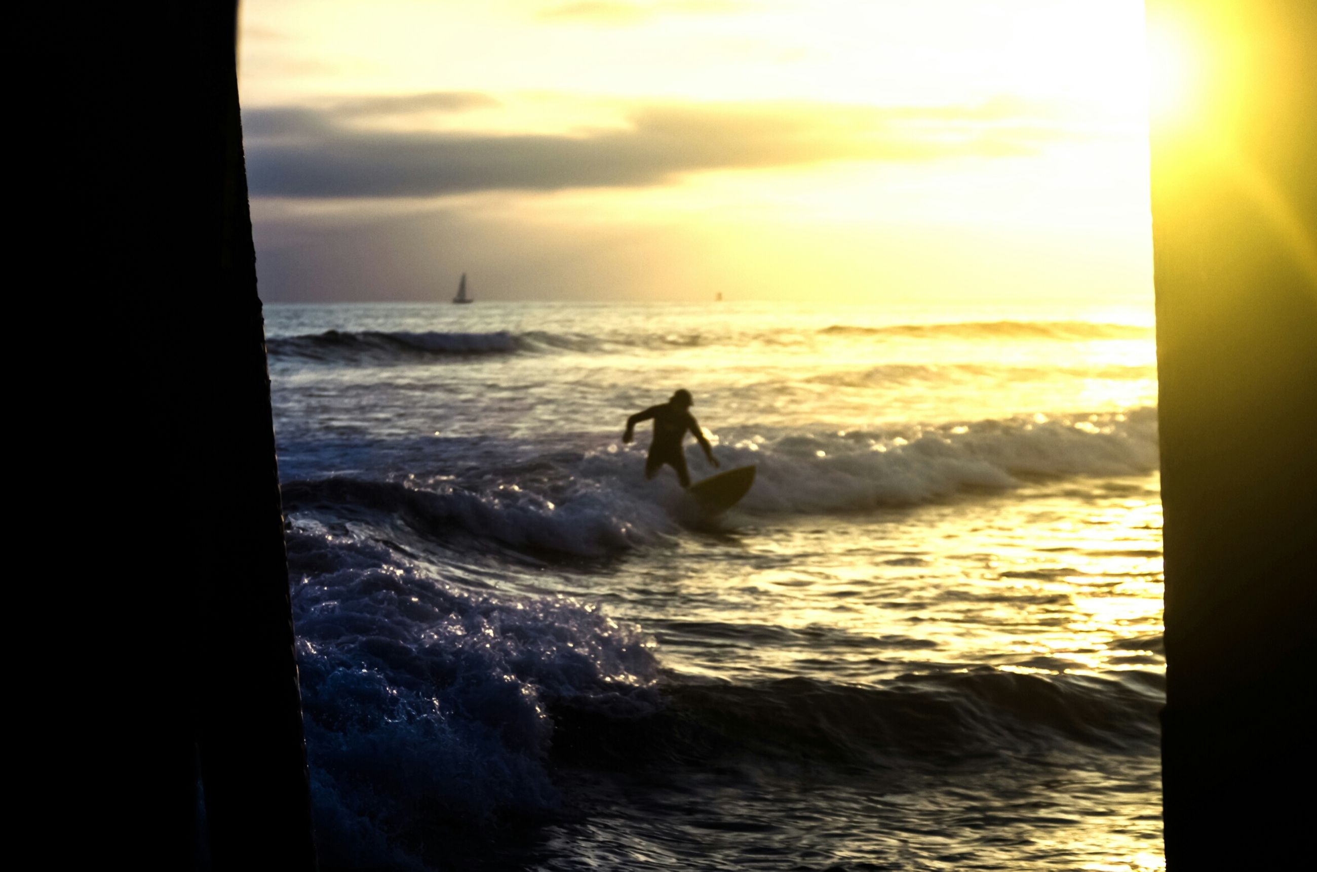 sea, water, horizon over water, sunset, beach, silhouette, sun, scenics, wave, sky, beauty in nature, leisure activity, nature, tranquil scene, sunlight, tranquility, lifestyles, shore