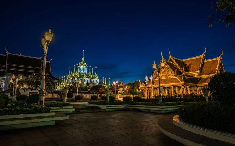 Bangkok Thailand. Golden Thailand Wat Ratchanatanaram Worawihan Architecture Blue Sky Building Exterior Built Structure Gold Colored Illuminated Light And Shadow Night No People Outdoors Place Of Worship Rajchadumnuen Road Religion Sculpture Sky Spirituality Statue Temple Travel Destinations