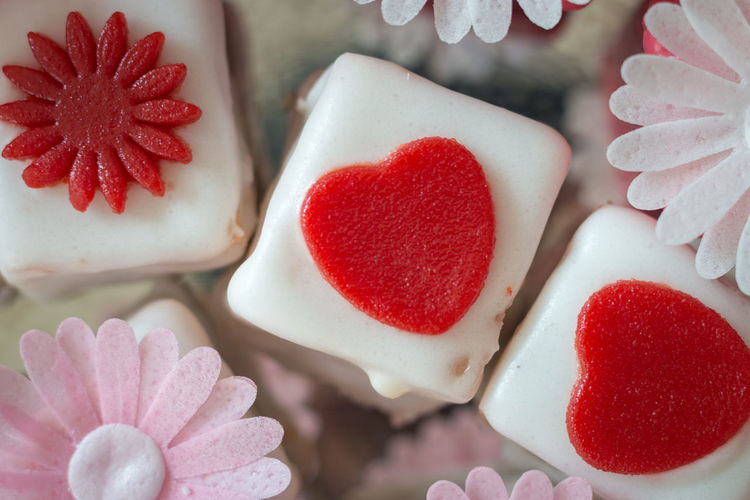 Close-up of colorful petit fours with flower decoration