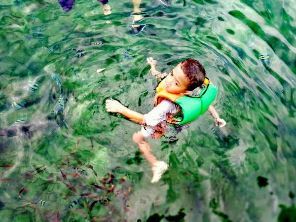 Floating at the Coral Island, Pulau Pangkor, Perak , Malaysia.Pangkor Island Malaysia Sea View Coral Fish Kids Having Fun Floating On Water Break The Mold EyeEmNewHere Clear Water Crystal Clear Waters The Great Outdoors - 2017 EyeEm Awards Neighborhood Map Live For The Story Done That.