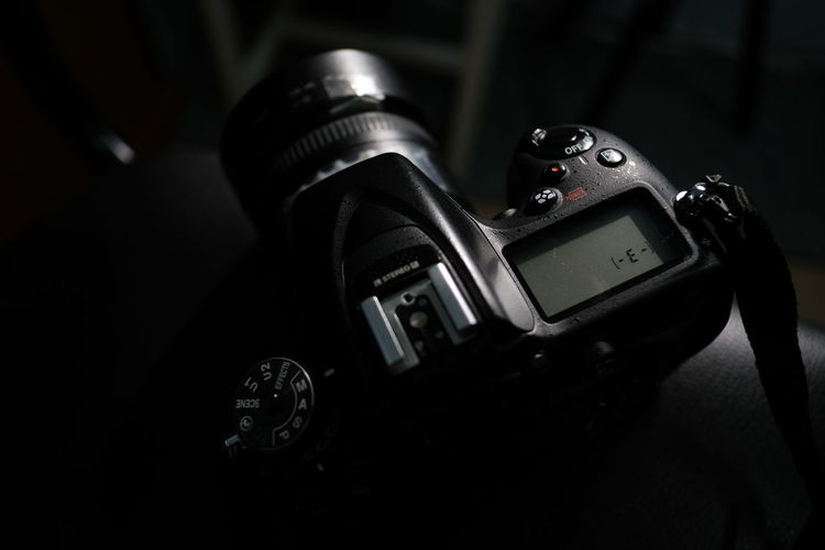 Camera - Photographic Equipment Technology Photographic Equipment Photography Themes Digital Camera Close-up Camera Retro Styled Indoors  No People Modern Focus On Foreground Lens - Optical Instrument Black Color Still Life Photographing Analog Equipment Number