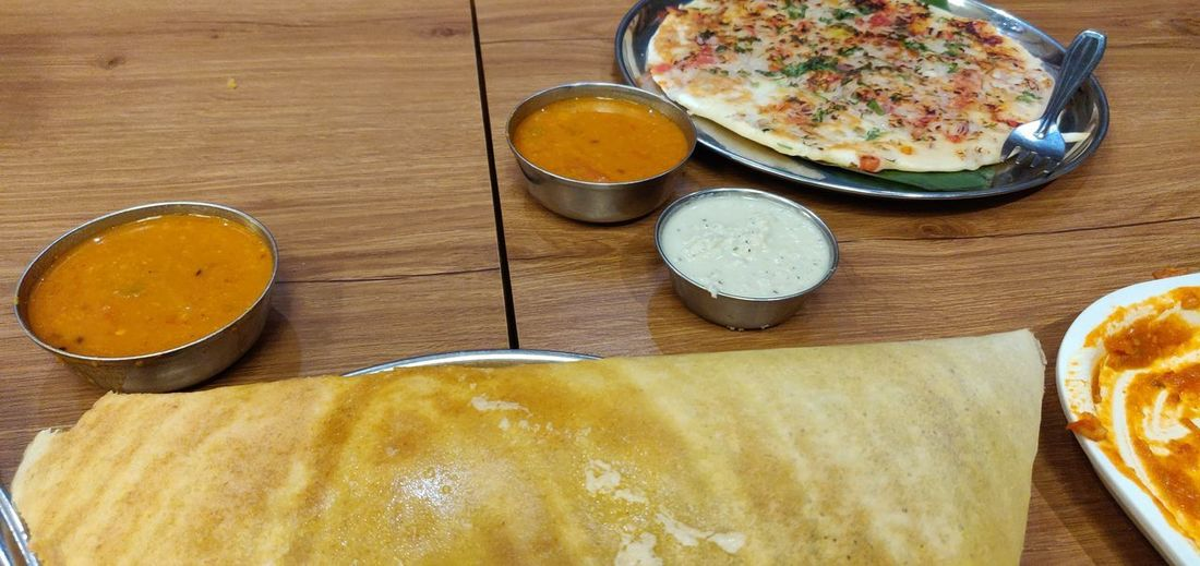 Dosa Uttapam Uttapa Sambar Chutney Coconut Chutney Egg Yolk Bowl Table Plate High Angle View Close-up Food And Drink Curry Gravy Cooked Served Prepared Food