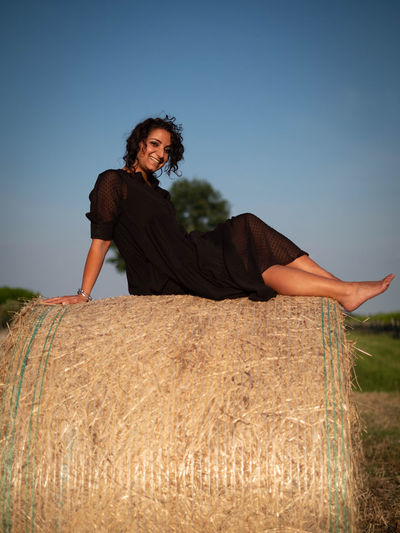 Smiling woman on bale