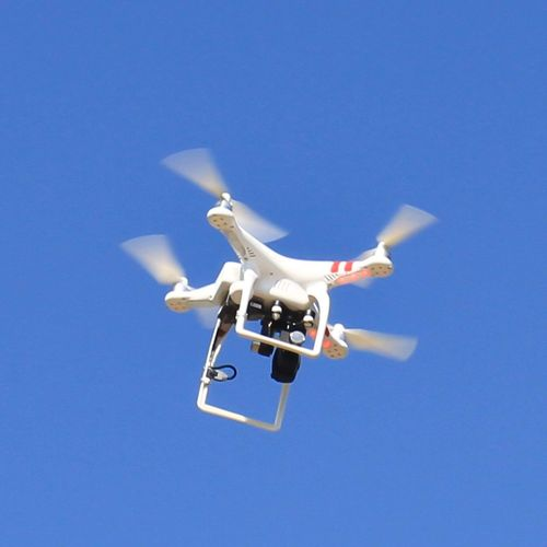 Drone Flying Air Vehicle Clear Sky Transportation Blue Mid-air Low Angle View Sky Helicopter Mode Of Transport Airplane Day No People Outdoors Technology Military Aerospace Industry technologyFlyly