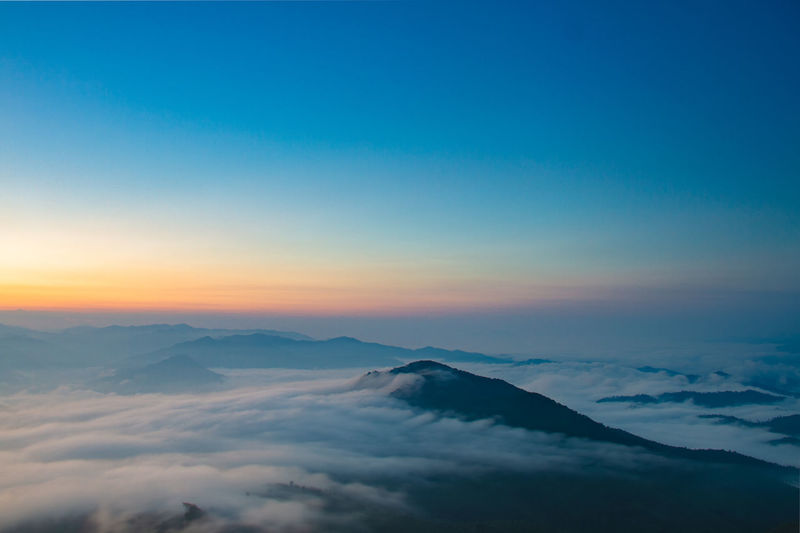 Sky Scenics - Nature Beauty In Nature Mountain Cloud - Sky Tranquil Scene Tranquility Sunset Nature Mountain Range Cloudscape Idyllic Majestic No People Copy Space Environment Non-urban Scene Blue Awe Mountain Peak Above EyeEmNewHere