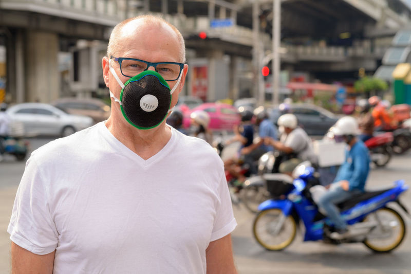 Portrait of man wearing mask on street