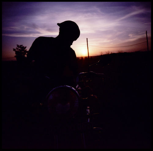 Silhouettes of Mpigi African Clouds African Silhouette African Sunset Analogue Photography Cleaning Motorbike Lomography Motorcycle Motorcycle In Sunset Mpigi Mpigi Sunset Rural Silhouette Travel Uganda  African Hut African Sun Bike East Africa Grain Hill Medium Format Portrait Sunset Xpro