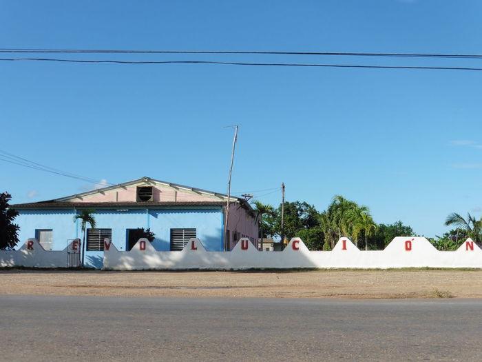 Cuba Travel Revolution FidelCastro Che Guevara Outdoors Blue Building Exterior Sky House Architecture Day Politics And Government
