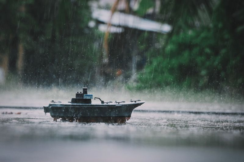 Model Battleship, rain, water Battleship Vintage Photo Water Nautical Vessel Mode Of Transportation Nature Transportation Outdoors No People Snowing Rain Motion Wet Environment Scenics - Nature Reflection