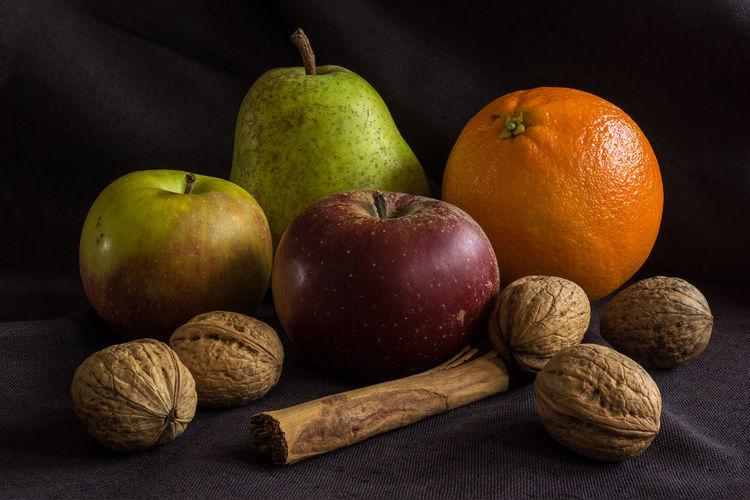 Apples Black Background Cinnamon Sticks Close-up Food Fruit No People Oranges Pear Still Life