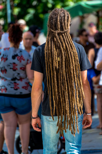 Casual Casual Clothing Close-up Day Focus On Foreground Hair Style Leisure Activity Lifestyles Long Hair Man Outdoors RASTA Rasta Love Rear View Selective Focus Standing Street Photography Sunny Day Tribe Urban Young Man