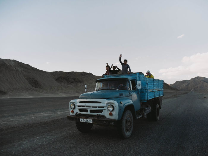 On our way back to Murghab from the Ak-Baital Crater we passed this blue truck with some kids in the back. They were so happy to see us and were shouting and waving until we were far in the distance. I just wanted to stop our vehicle and jump in for a ride with them. Central Park EM1 Olympus Tajikistan The Street Photographer - 2018 EyeEm Awards Desert Documentary Em1mk2 Land Vehicle Landscape Mode Of Transportation Motor Vehicle Mountain Off-road Vehicle Real People Road Trip Transportation Truck Week On Eyeem The Photojournalist - 2018 EyeEm Awards The Great Outdoors - 2018 EyeEm Awards The Traveler - 2018 EyeEm Awards Be Brave A New Beginning A New Perspective On Life Capture Tomorrow
