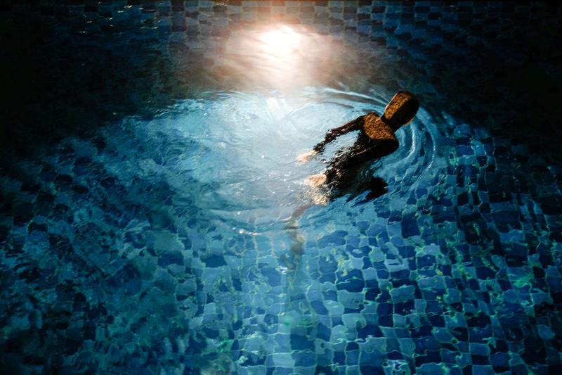 Man swimming in pool