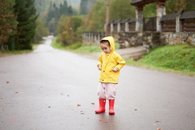 Full length of boy standing on road