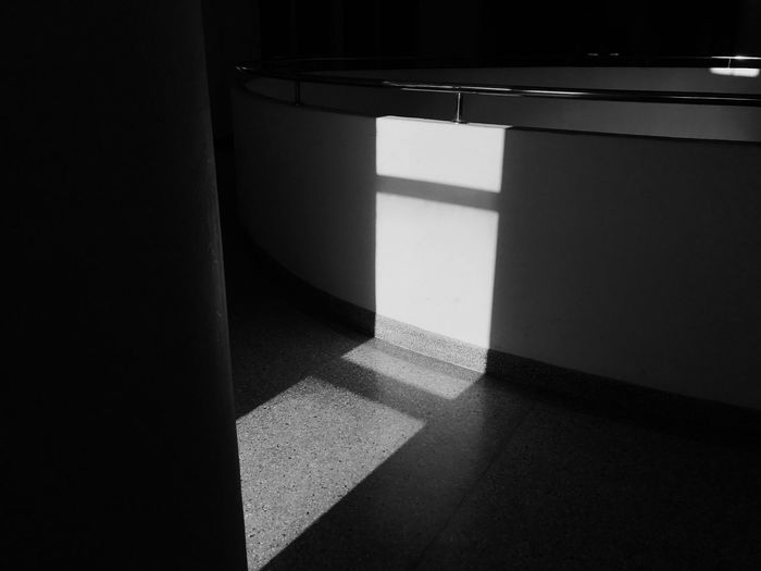 High angle view of sunlight falling on tiled floor at home