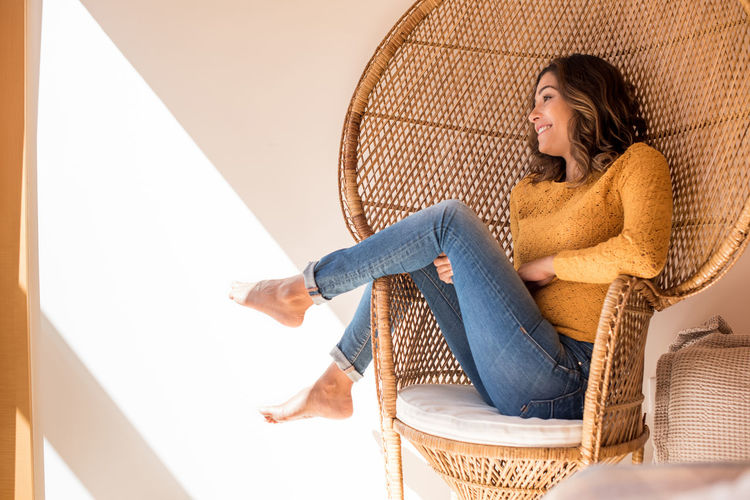 Young woman sitting on seat