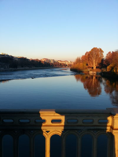 I took this pic several years ago from a bridge over the Po river, in Turin, during an autumn sunset. I like that surface so calm and that reflections. Reflection Outdoors Clear Sky No People Built Structure River Bridge Architecture Trees Enjoing Life Hello World Beauty In Nature Getting Inspired Atmosphere Lights And Shadows Live For The Story Getting Creative EyeEm Nature Lover From My Point Of View Landscape Horizon Over Water