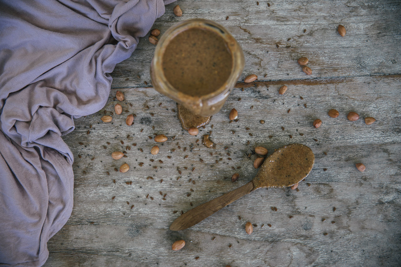 directly above, food and drink, drink, cup, one person, kitchen utensil, spoon, coffee - drink, wood - material, eating utensil, coffee cup, freshness, refreshment, mug, indoors, coffee, high angle view, human body part, food, table, human foot