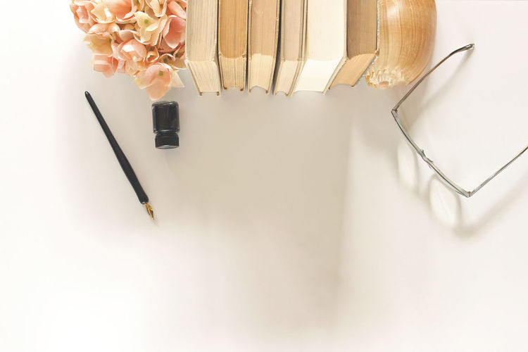 Reading and writing Author Beautiful Space Beauty In Nature Books Border Desk Top Eyeglasses  Fiction Flowers Frame Hardcovers Hydrangea Library Literature Mock Up Open Space Overhead Pen And Ink Seashell Styled Scene Template Top View Vintage Worn Books Writer