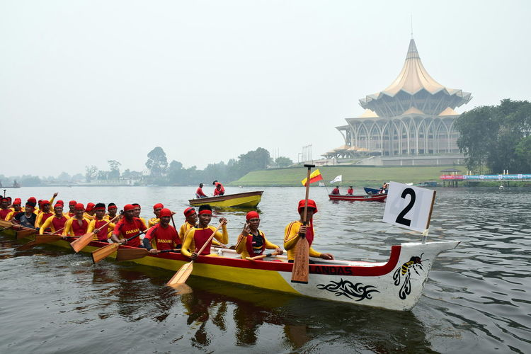 the paddle boat race during sarawak regatta 2016 on hazy day Architecture Building Exterior Built Structure Day Hazy  Hazy Days Large Group Of People Leisure Activity Lifestyles Men Mode Of Transport Nature Nautical Vessel Outdoors Paddle Paddleboarding People Place Of Worship Real People Regatta Regatta Weekend Sky Travel Destinations Water Women