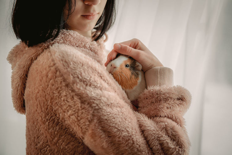 Midsection of woman with stuffed toy