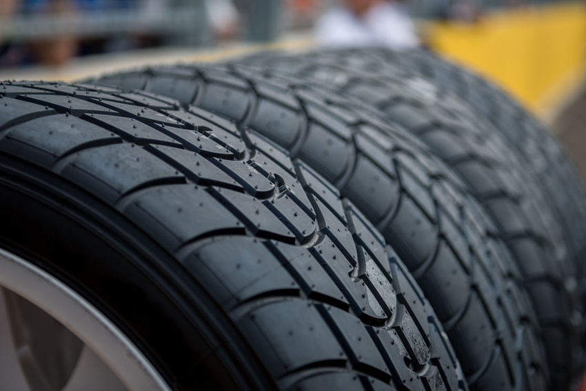 Auto Repair Shop Black Color Car Close-up Focus On Foreground Land Vehicle Man Made Man Made Object Mode Of Transportation Motor Vehicle No People Pattern Race Rubber Shopping Sport Tire Transportation Tyre Vehicle Part Wheel