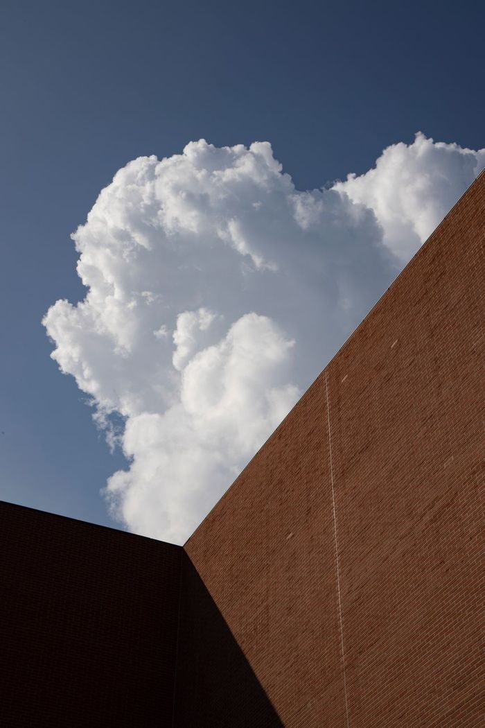 Low angle view of wall against sky