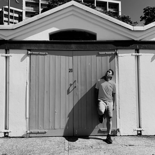 Twenty Three. Street Art Photography. Newzealand monochrome photography Monochrome Blackandwhite Architecture Building Exterior Built Structure Full Length Entrance Door The Art Of Street Photography Real People Sunlight Nature Wall - Building Feature Building People Standing City Men Lifestyles Day Outdoors