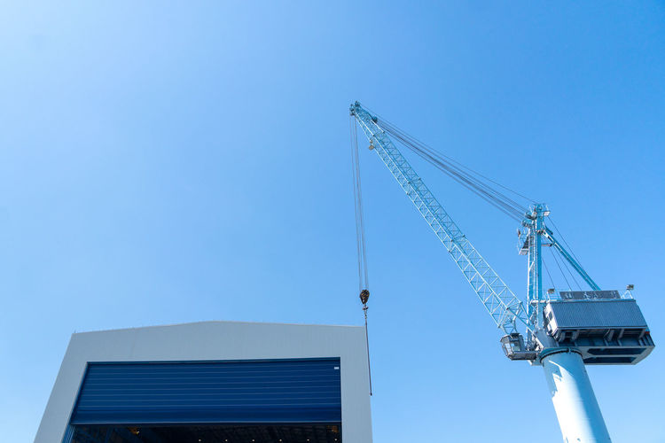Nature Day Outdoors Summer Blue Copy Space Docks Sky Industry Business Crane - Construction Machinery Low Angle View No People Tall - High Construction Site Progress Change