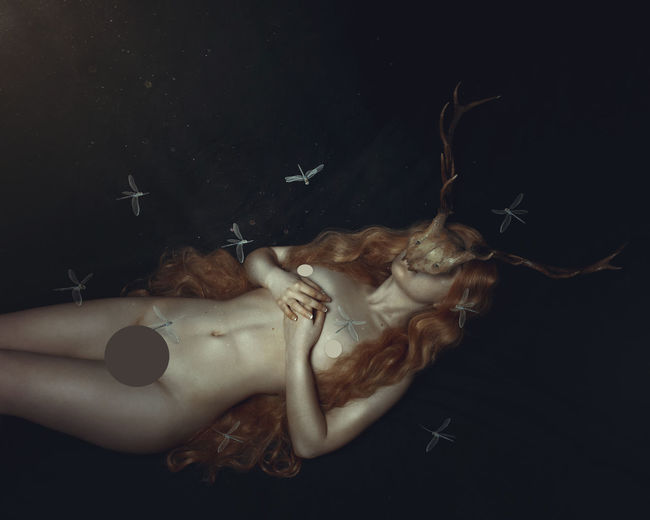 Digital composite image of woman lying down against black background
